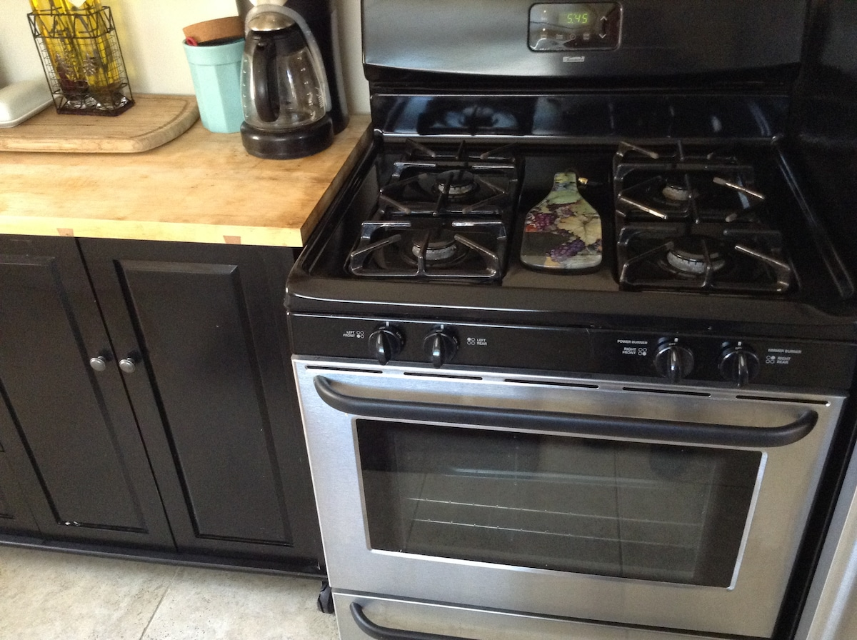 Kitchen with gas stove and all the cooking items you need.
