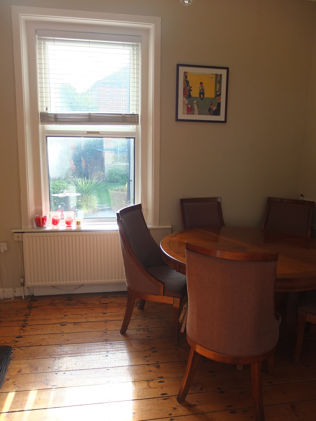 Dining room with seating for six and window with view to back garden