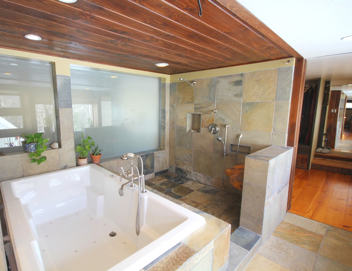 Airbath fits two people. Roman-inspired bathing/shower room is full of light with garden views.