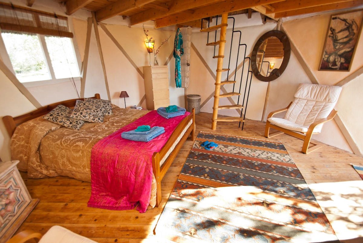 This is the bedroom in the pixie hut. It has a very cute attic room upstairs with another double bed.