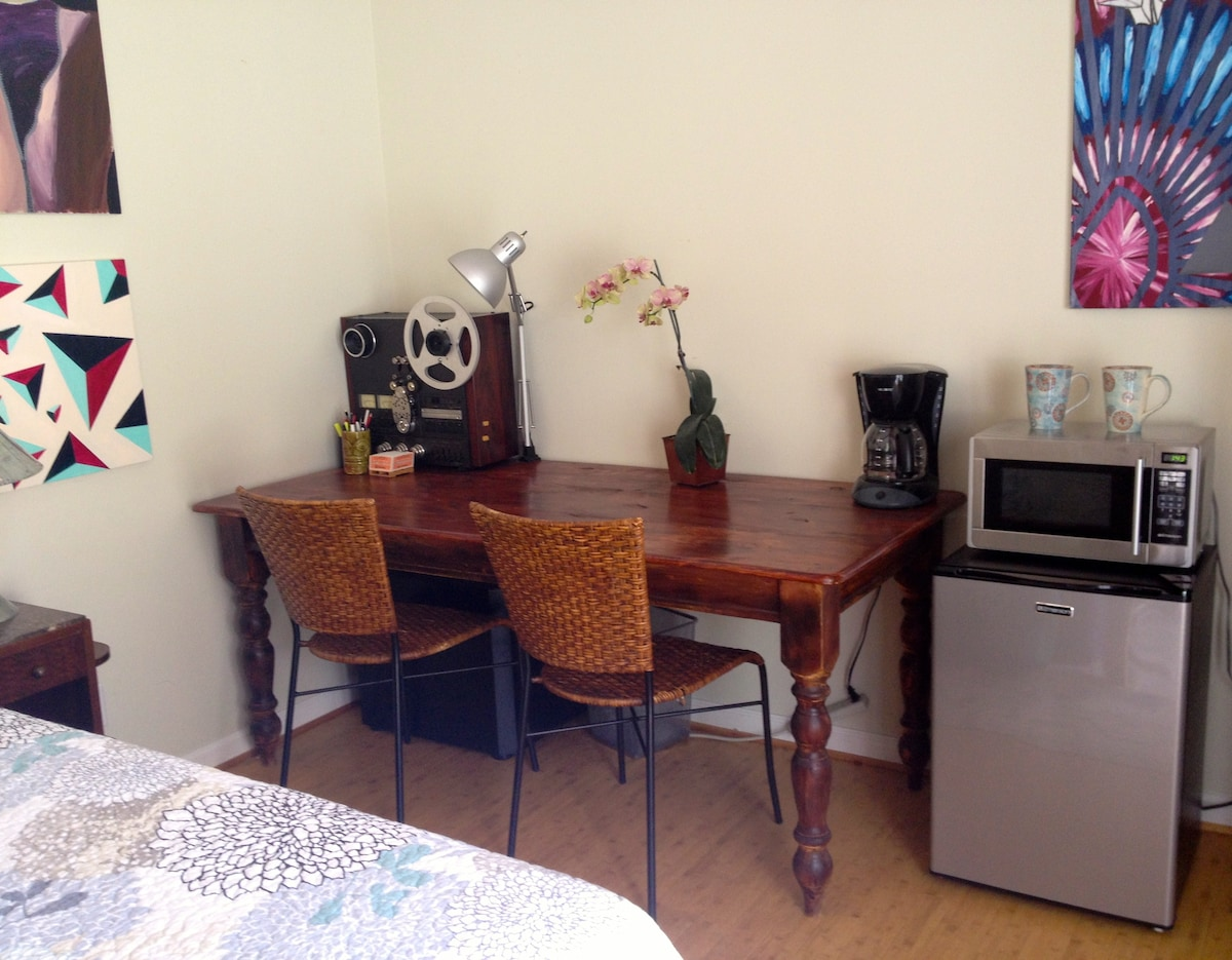 Full size table for work or dining. Mini fridge, coffeemaker and microwave.