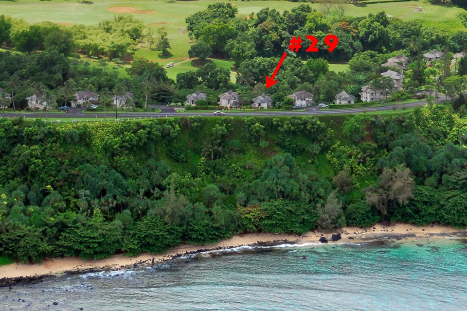 Perched on the ocean bluff with secluded beach below.