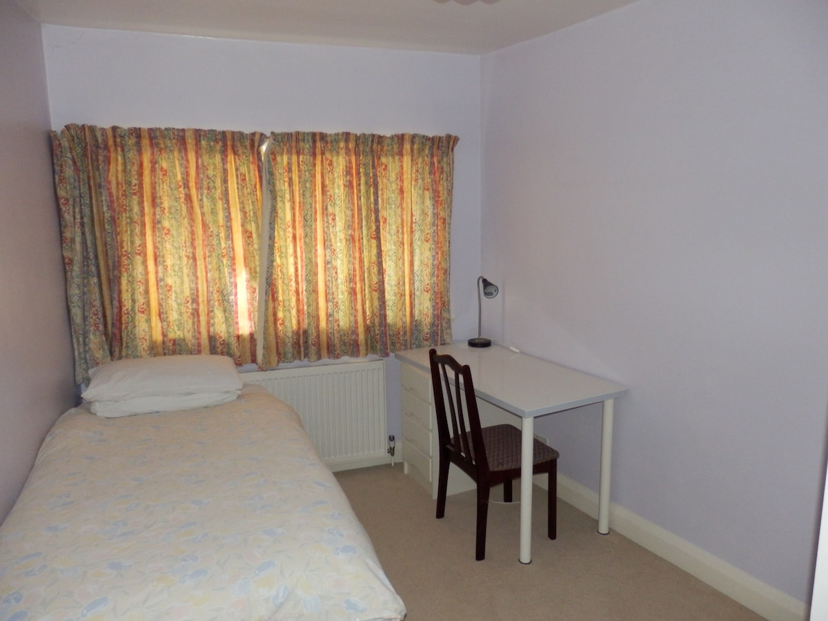 The bedroom with bed and desk. An extra bed can be added and the desk moved to the front if required for double occupancy.