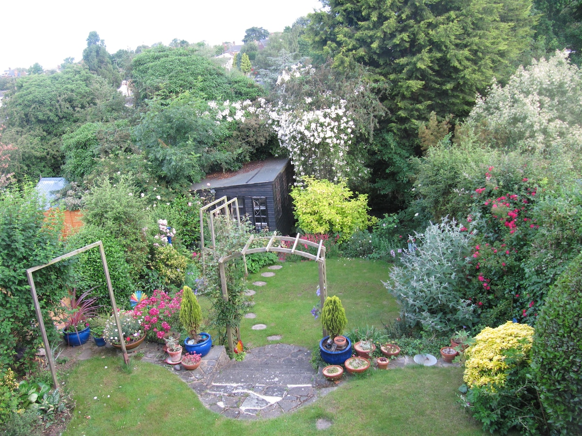 View of the garden and studio from the guest room.