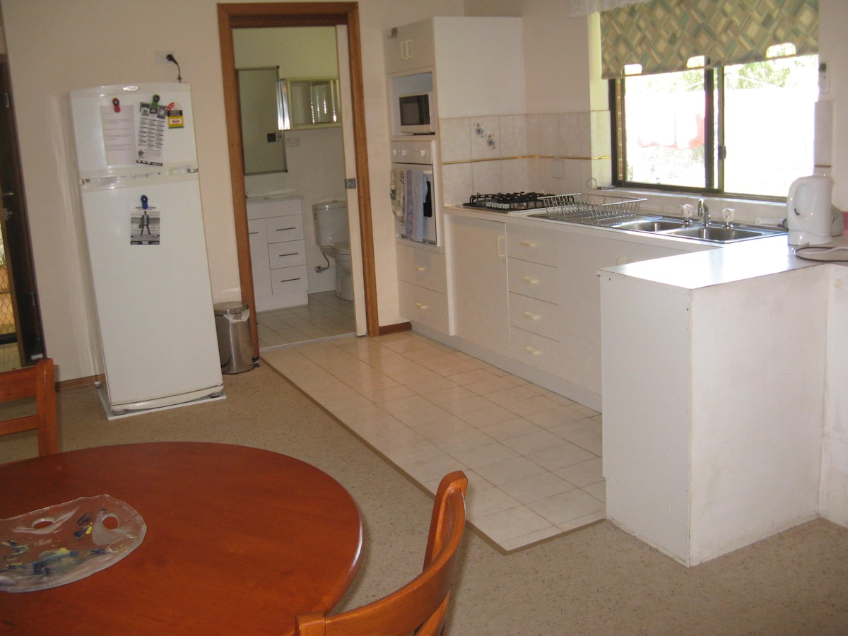 Kitchenette, gas cooktop, electric oven, microwave and fridge.  Bathroom with shower, handbasin and toilet.
