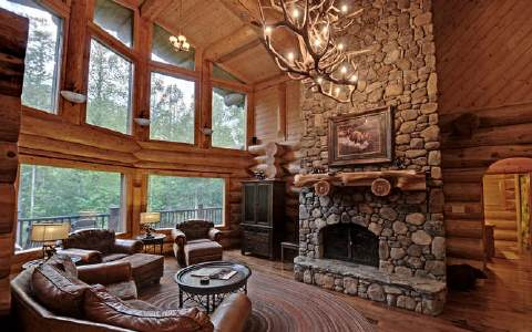 Great Room with spectacular views of the Toccoa River, wood burning fireplace ( firewood is not provided).
