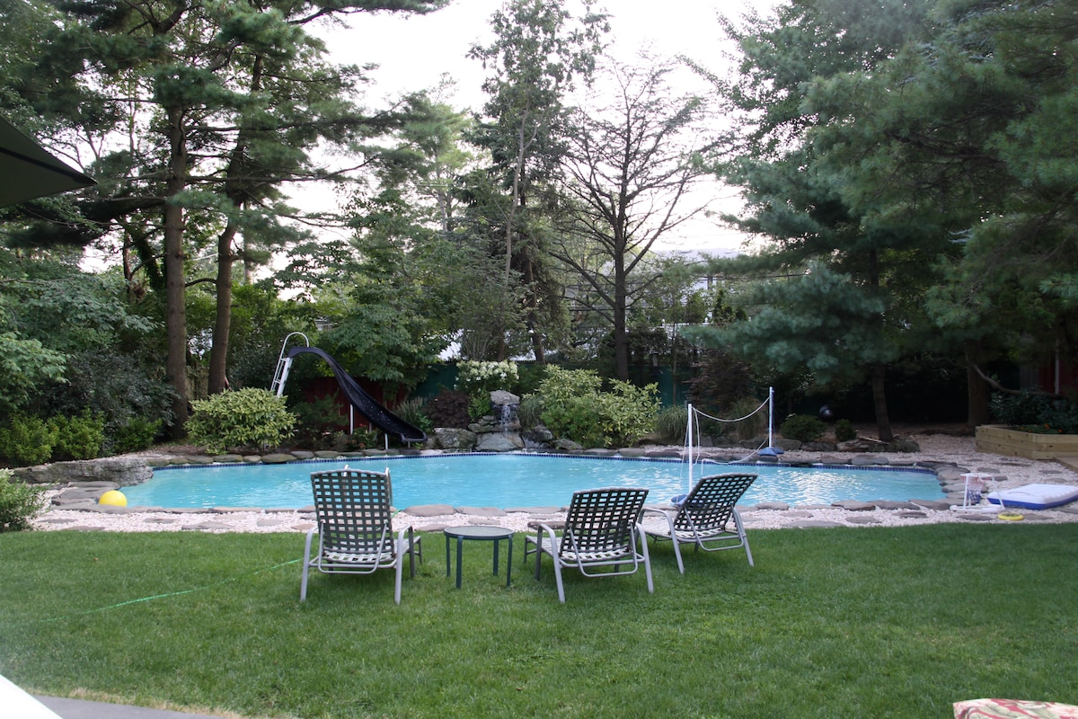 The backyard pool is heated all season and is surrounded by beautiful privacy hedges. There are vegetable gardens and flowers that bloom all summer.