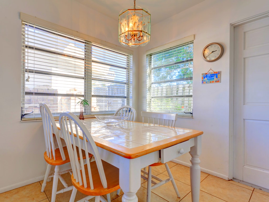 Play a round of Monopoly on our dining room table. Our bright, casual dining table is perfect for vacation meals. Dining out? You'll find this space perfect for playing Monopoly and Blockus.