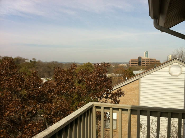 Balcony over-looking parts of downtown and a wide swath of the green belt