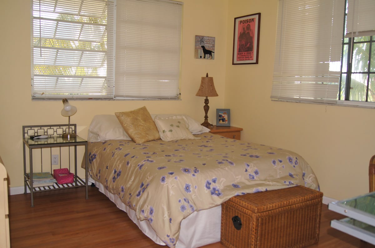 Comfortable clean room with a dresser and closet