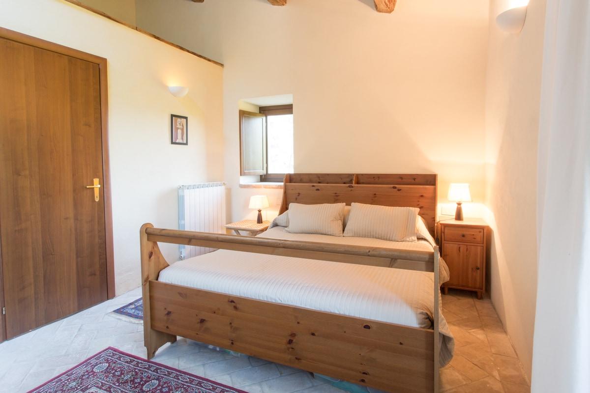 Master bedroom with door to ensuite
