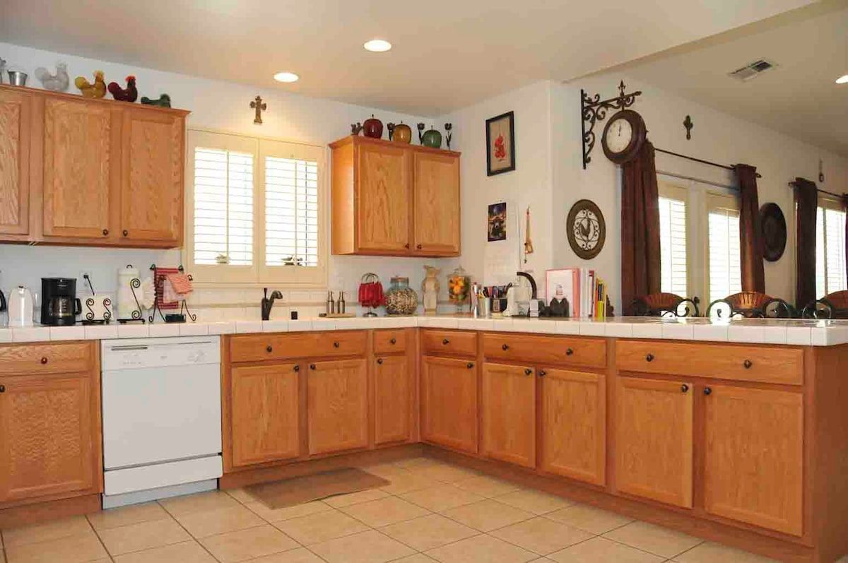 spacious open kitchen come fully stocked with everything you need.