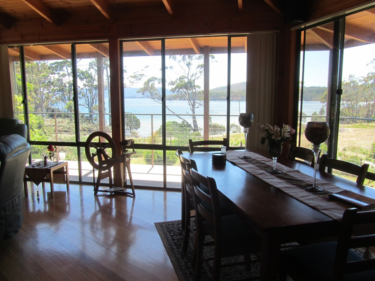 Looking through the window of our lounge/dining area with Daniels Bay in the background.