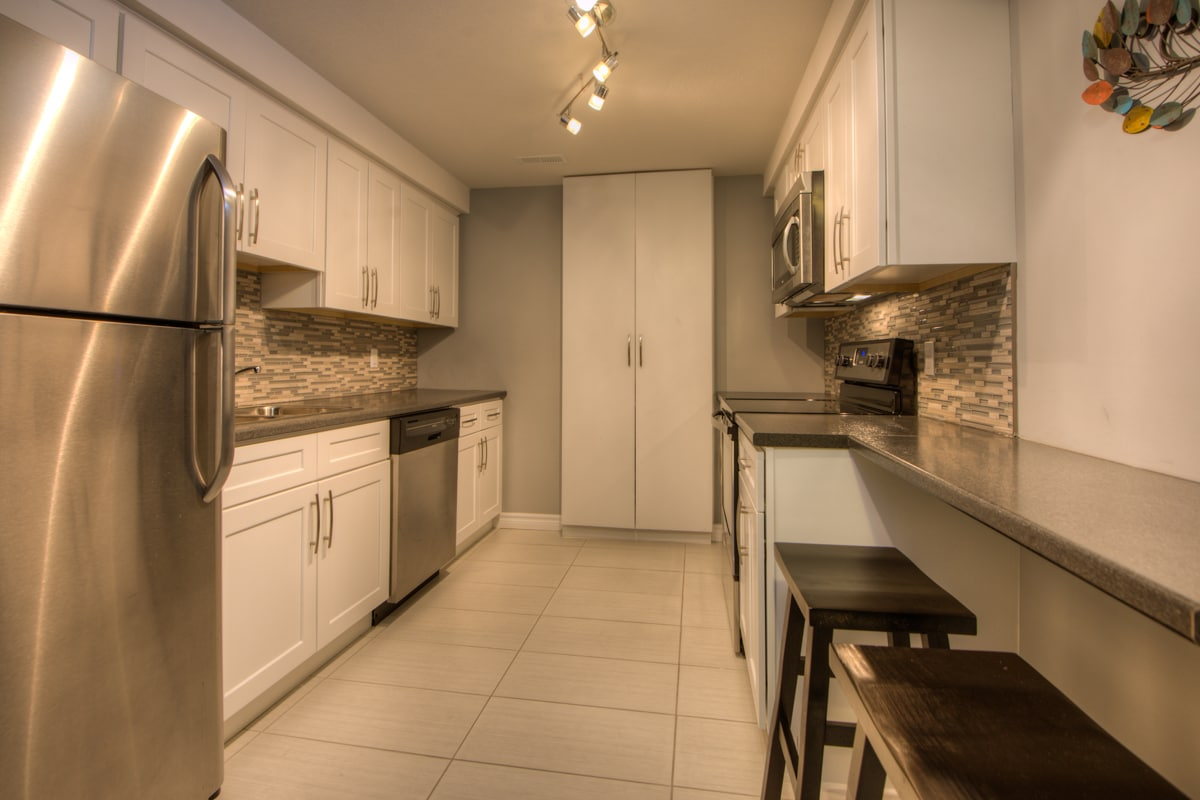 The maple kitchen cabinetry and 4 stainless steel appliances, gorgeous stone and glass backsplash, and everything you need to get busy in the kitchen; makes it stunning AND functional.