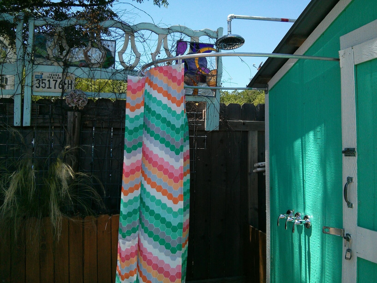 The outdoor shower feels amazing after playing in the Texas sun.