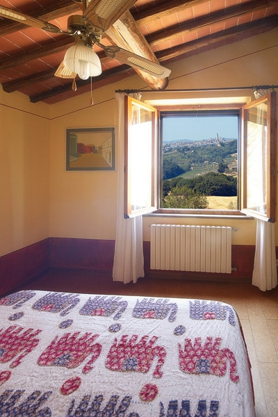 Suite and the view over the 800-year old historic centre of Siena