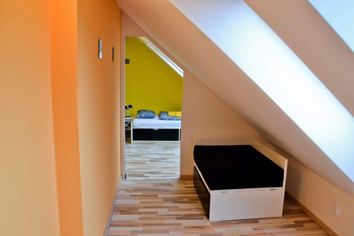 Hallway to bedroom, extra bed on the right