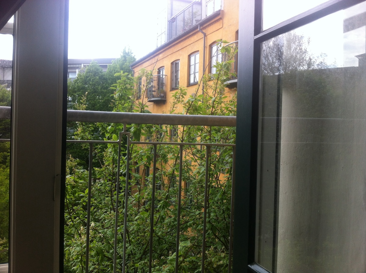 View from small balcony overlooking backyard.
