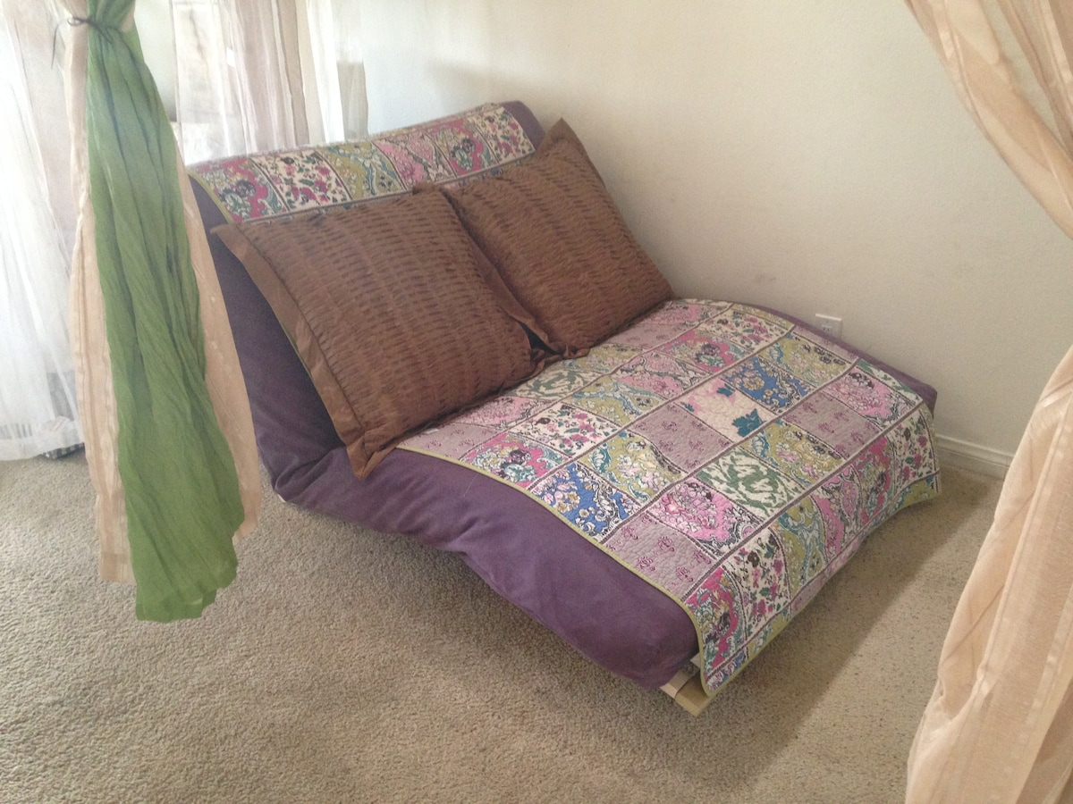 Daytime: Futon makes for casual Seating.  (Guest area #1)
