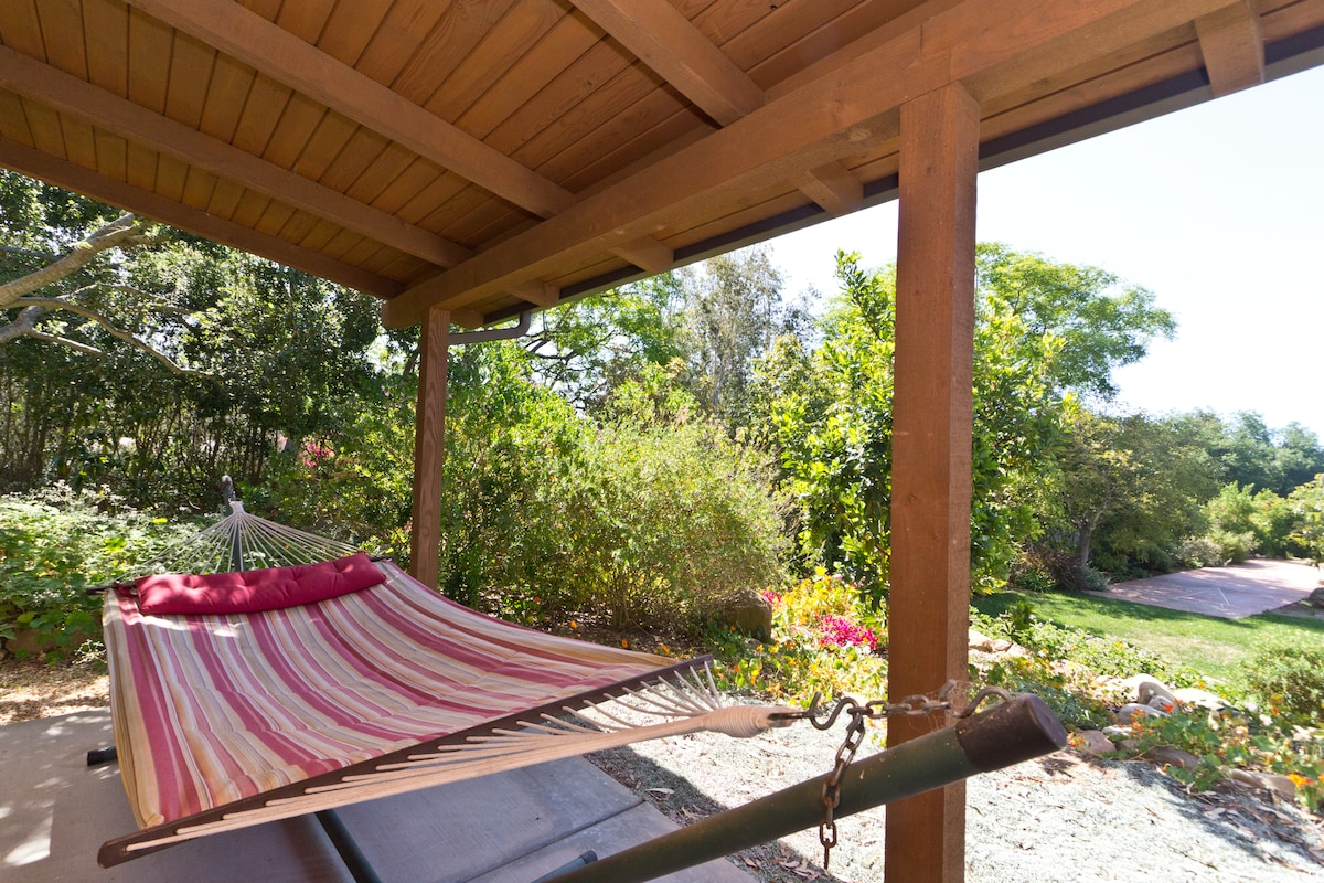 Enjoy the sight and sounds of birds from the patio on our comfy hammock!