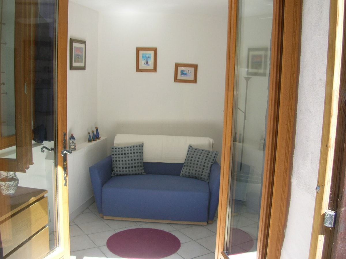 Sofa for relaxing with view to terrace