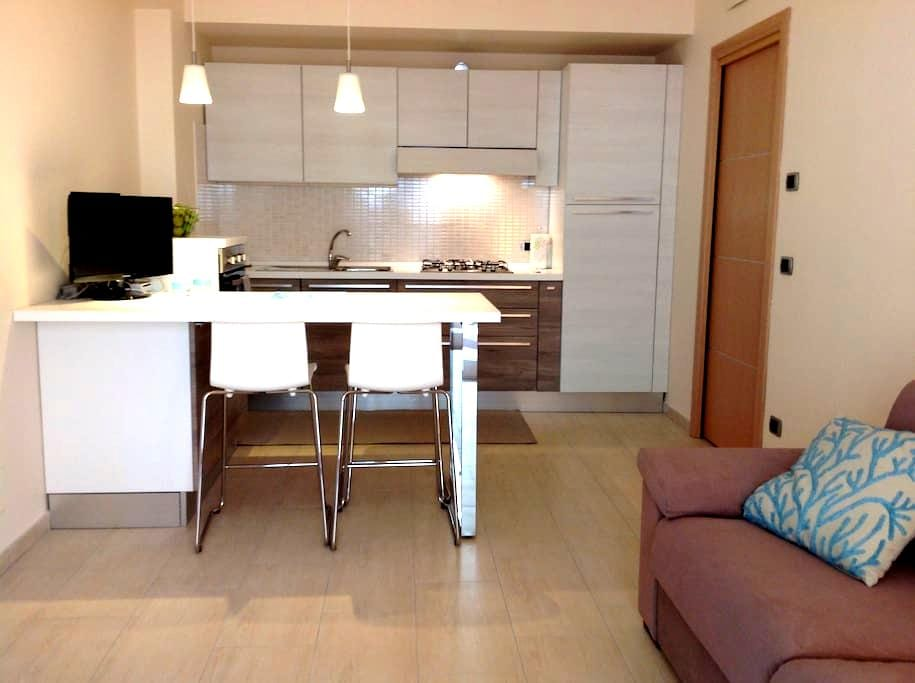 New flat a few steps from the beach - Mazzeo - Apartmen