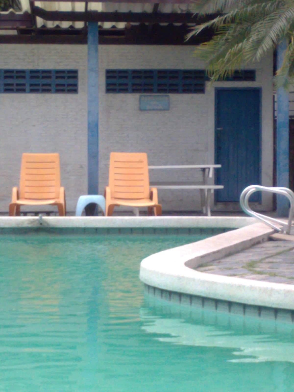Free-form swimming pool-3steps away