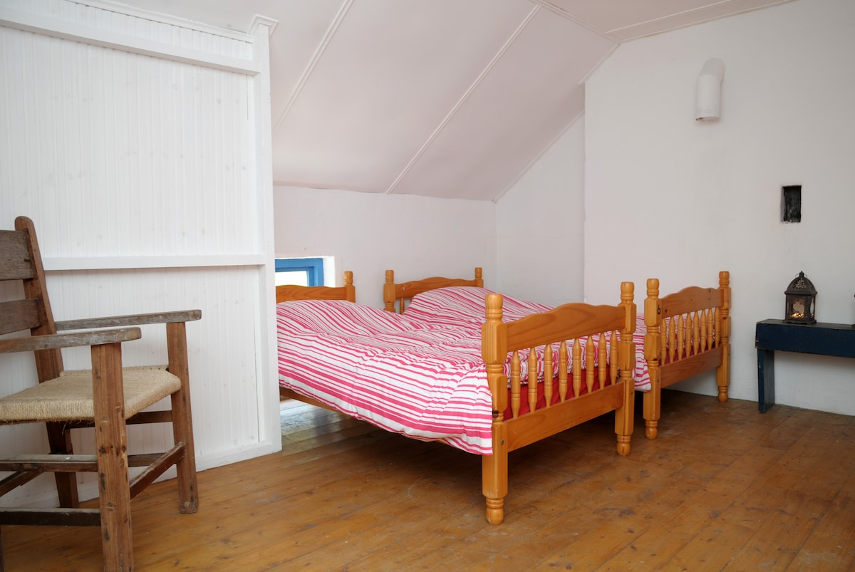 This is the shared accommodation four beds in this large room.