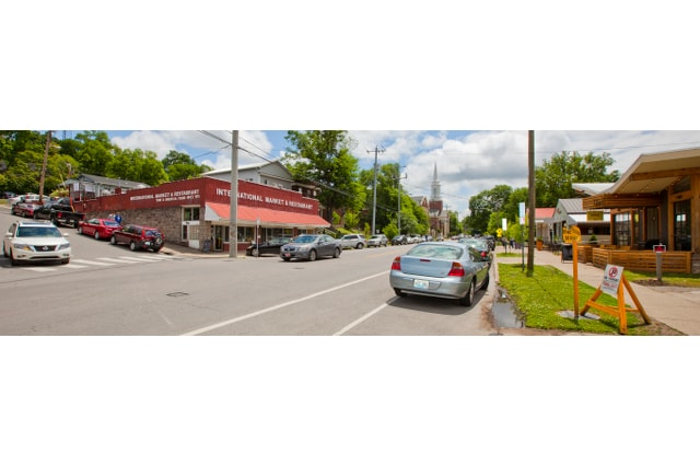 This is Belmont Blvd -  The International Market, BLVD, PM & Bongo Java are all inviting you to walk down.