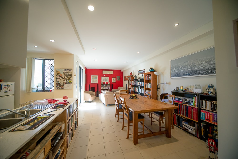 Living space is a large open plan area with a terrace leading off it