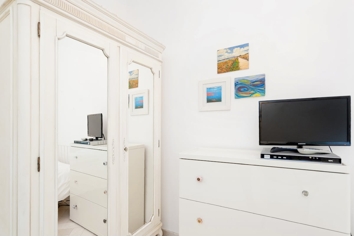 Your bedroom, with small TV, excellent wi-fi, lots of storage and hanging space, guidebooks, basket of toiletries, all the towels you need, hair dryer, umbrella, yoga mat etc.