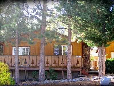 Little Pines Cabin, located in a quiet Wrightwood neighborhood surrounded by mountains and national forest land.