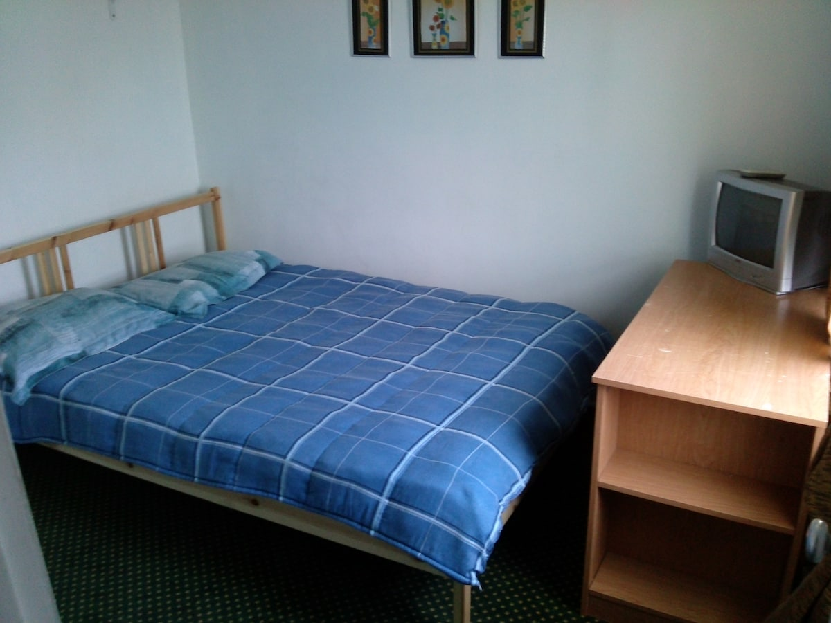 Double bed, Cable TV, writing table.