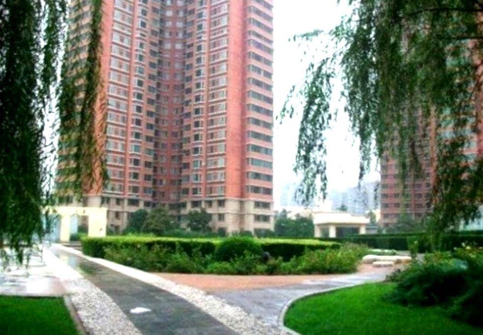 北京房屋-地铁站5分钟-地图定位准确-小区安全舒适-主人可供餐哦 - Пекин - Гестхаус