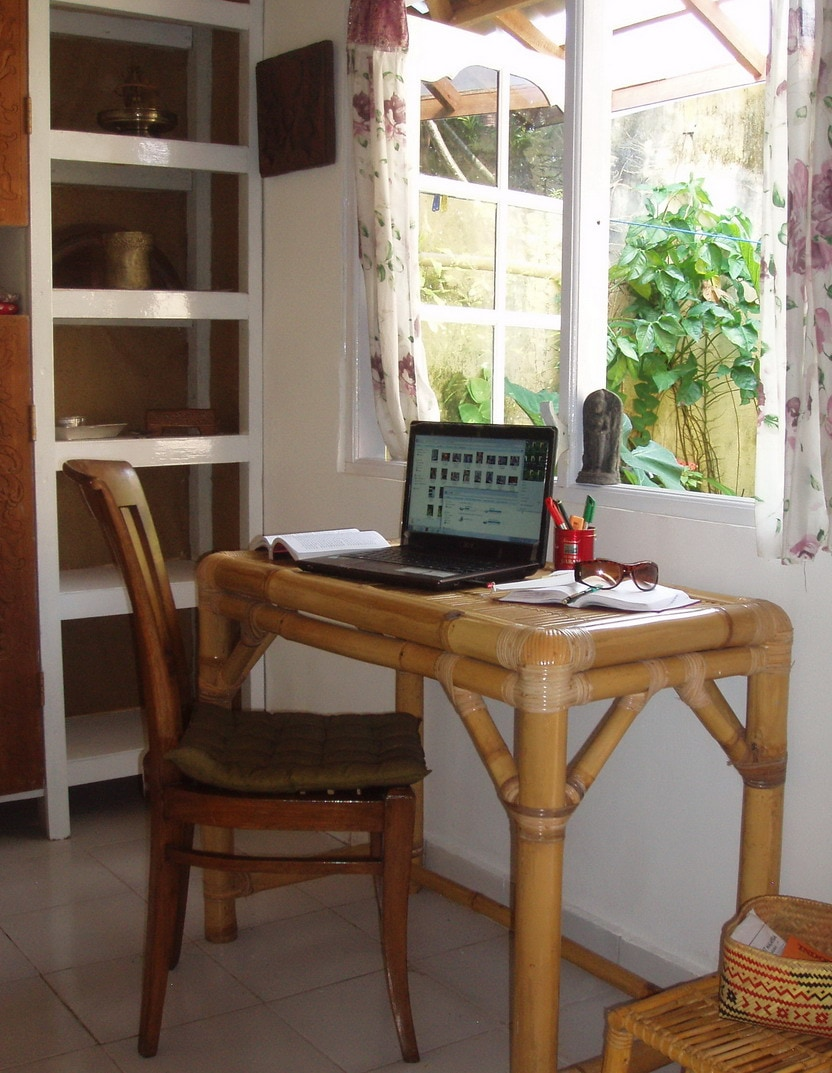UNLIMITED INTERNET. OVERLOOKING THE GARDEN  -- DESK MADE OF LOCAL SUSTAINABLE BAMBOO, ANTIQUE TEAK CHAIR