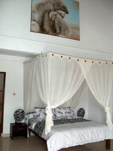 Polar Bear bedroom 2 with aircondtioning, vaulted ceilings, kingsized bed and ensuite bathroom with bathtub