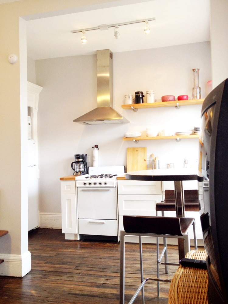 Sun-filled Kitchen w/ microwave, stove, coffee maker, toaster, refrigerator and farm-style sink