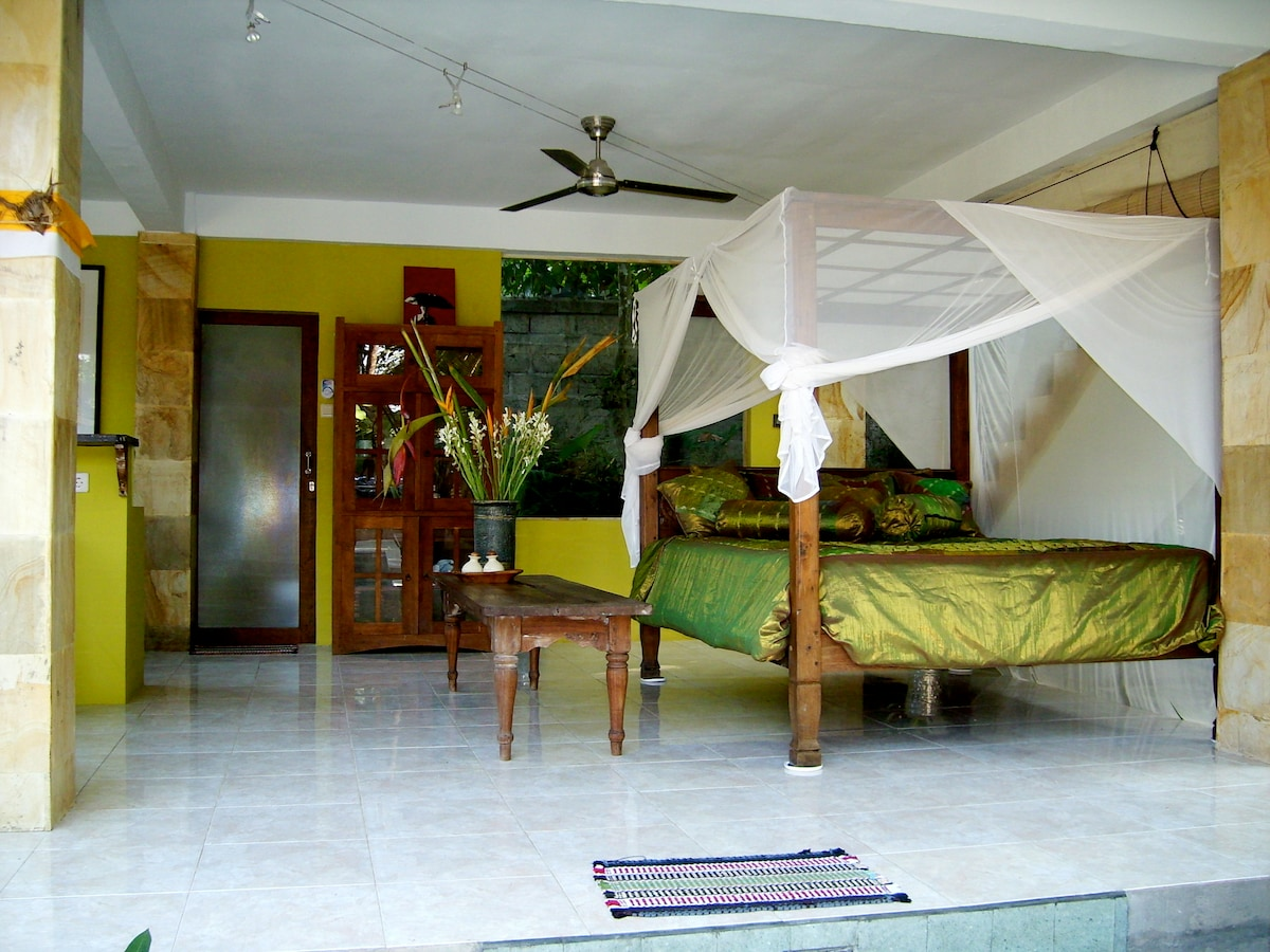 Our beautiful living room features a Bali Bed with mosquito netting.