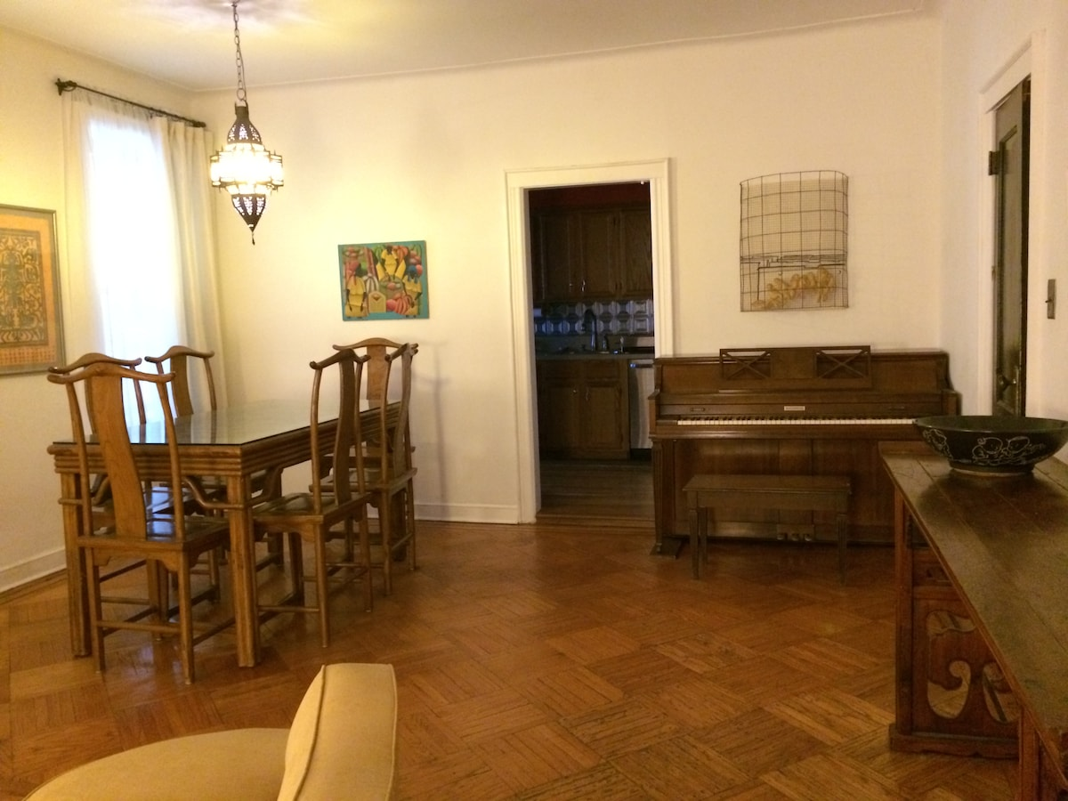 Spacious and open living/dining area. Table seats 6.  1980 Baldwin console piano.