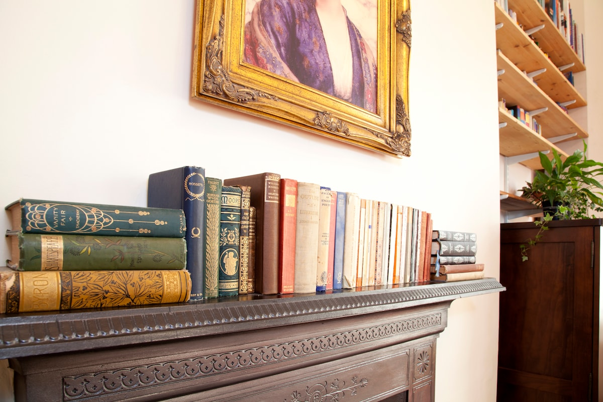 If you're feeling inspired you can peruse the antique books above the fireplace.