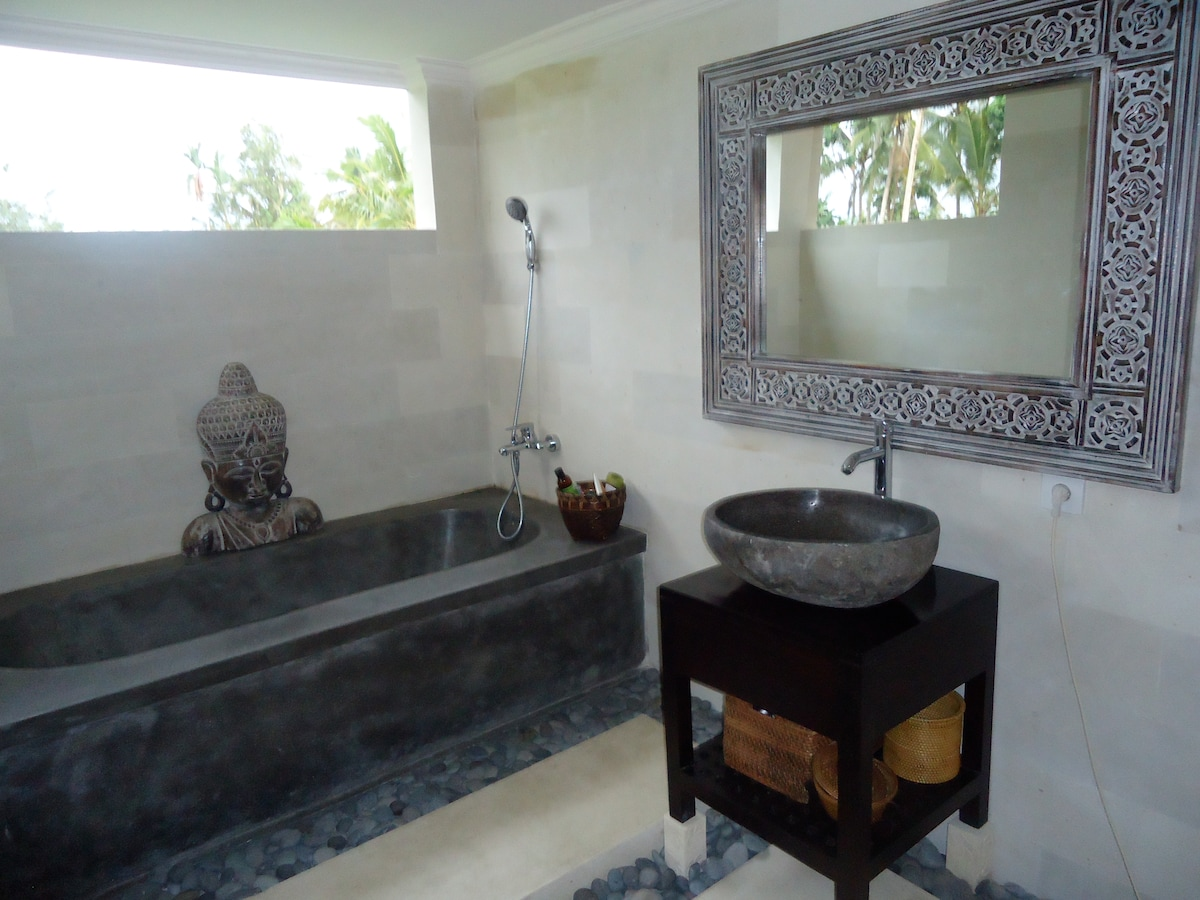 The Master Suite bathroom has open air views over the rice fields