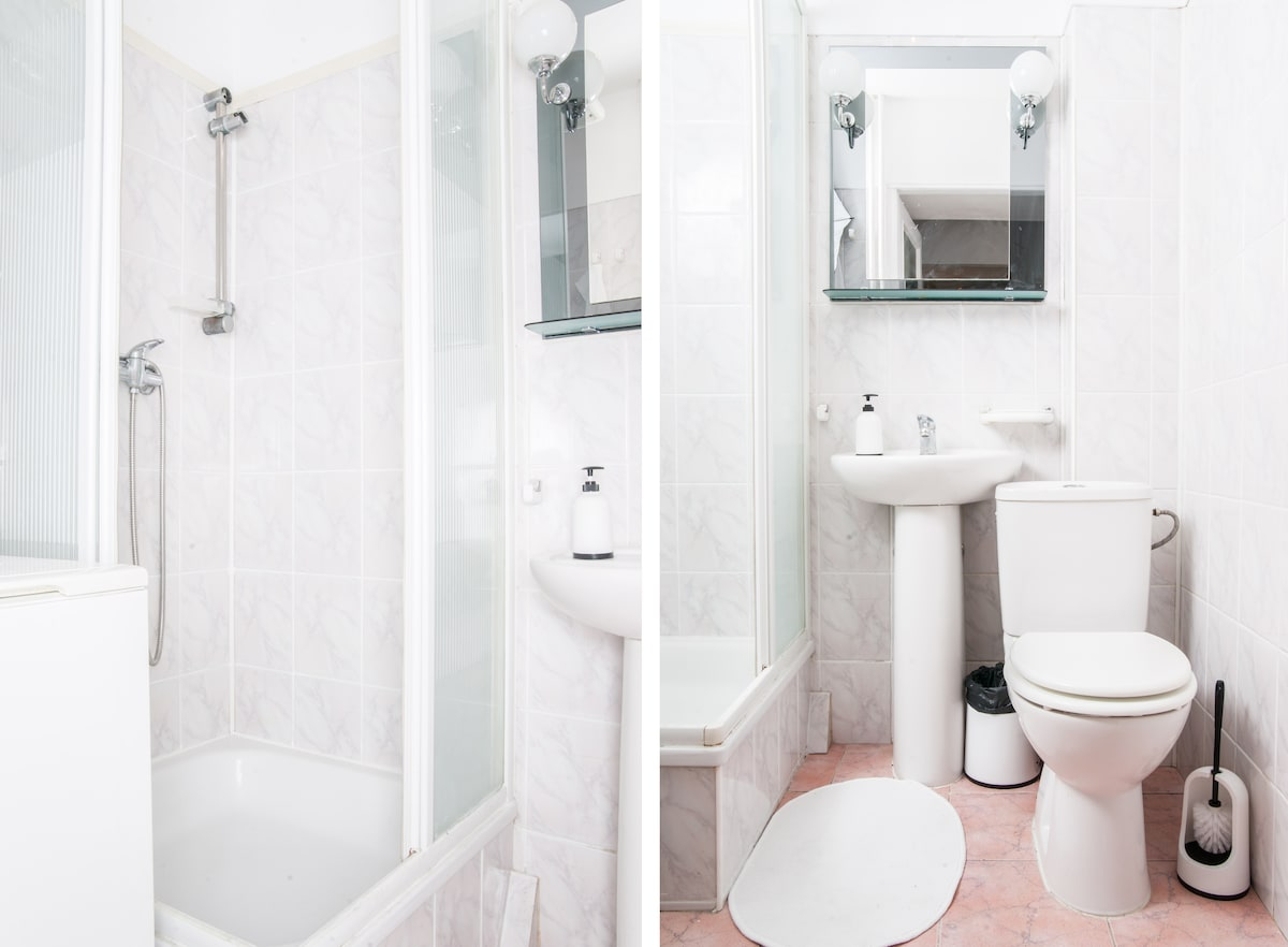 clean bright bathroom with all utilities needed - washing machine, hair drier etc.
