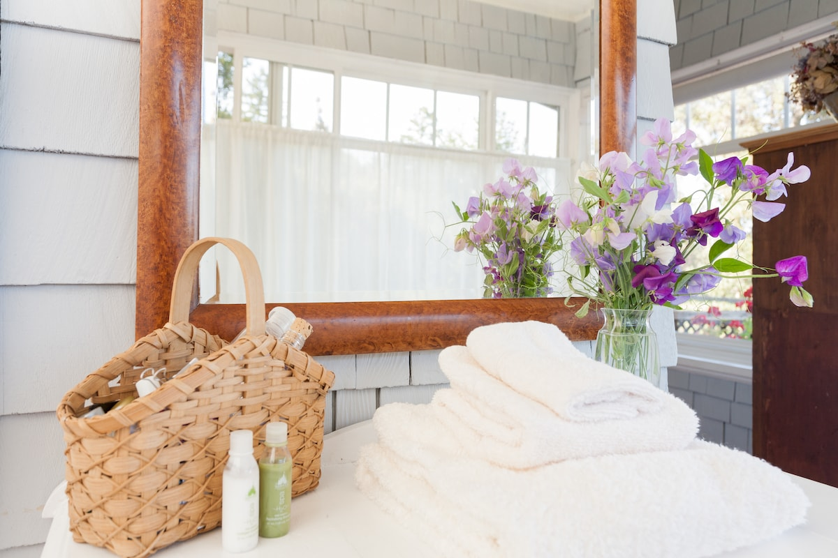 Fresh seasonal flowers, useful toiletries and extra towels for the spa.