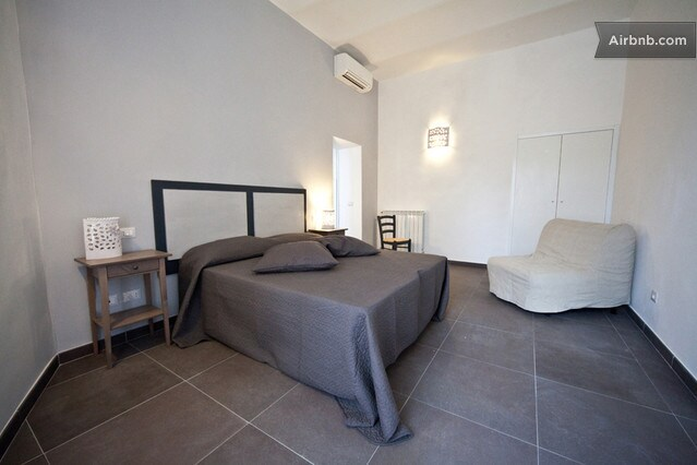 A very fine double room with an extra bed and private bathroom based on grey & white themes.