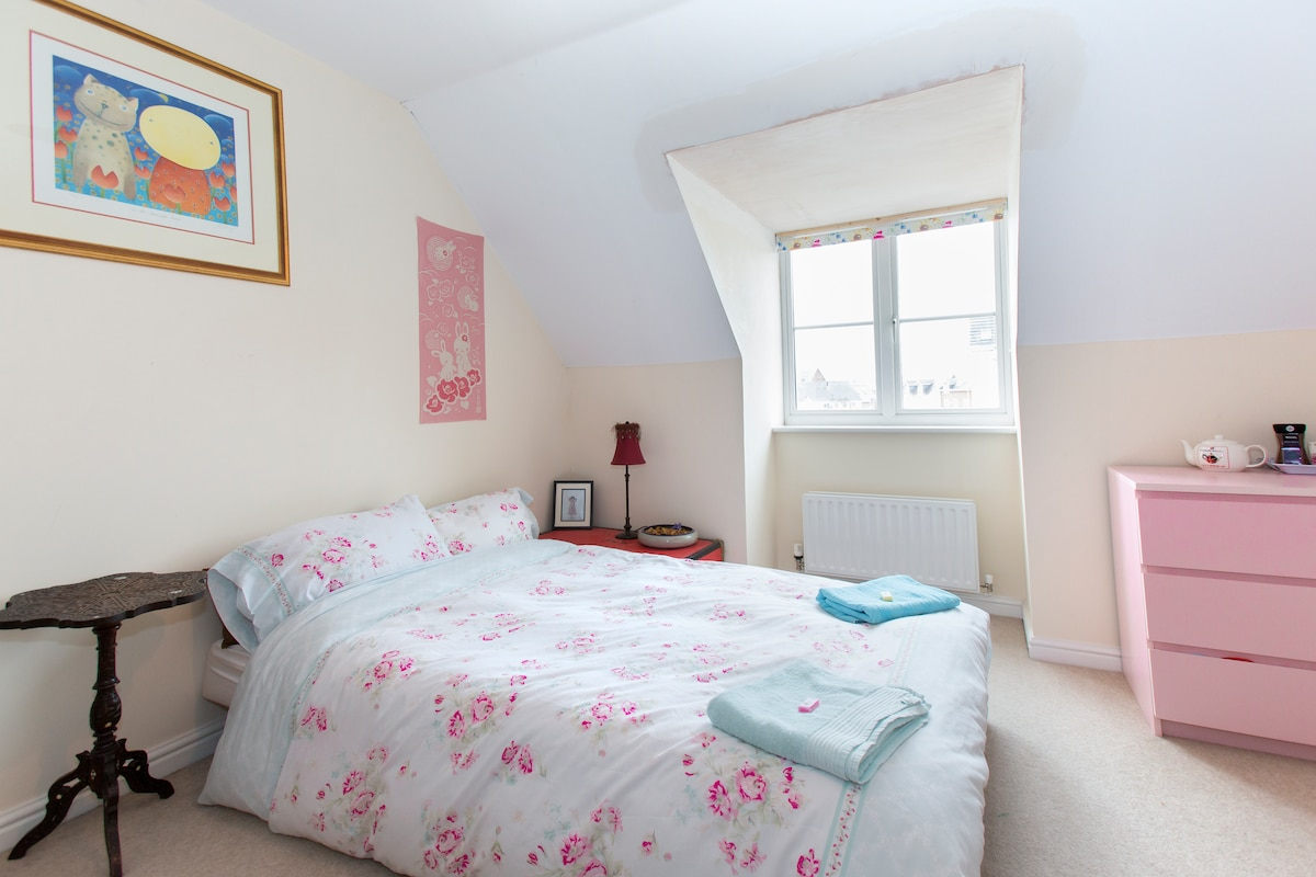 This double room has views to the south and to Cleeve Hill beyond