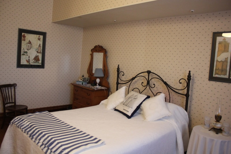 The Nautical Room has a Queen bed and a sitting area with wing back chairs