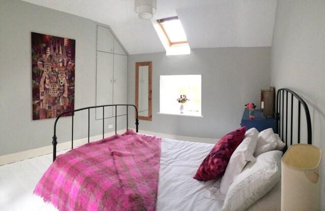The main double bedroom with window overlooking garden