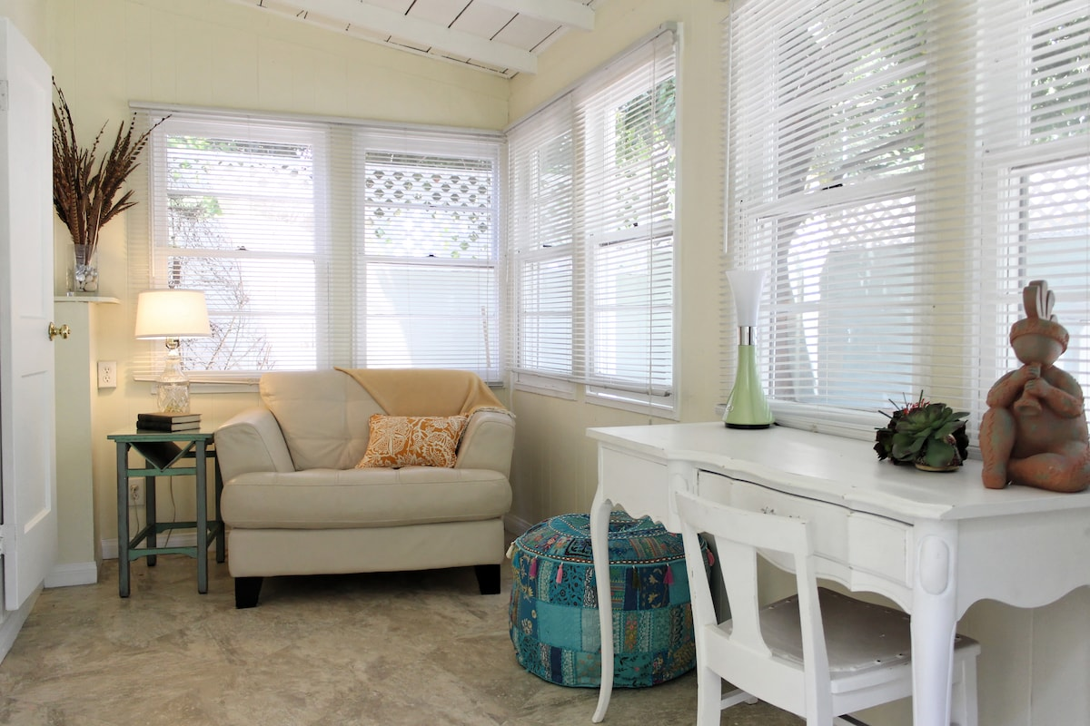 Back porch complete with desk and cozy reading chair.