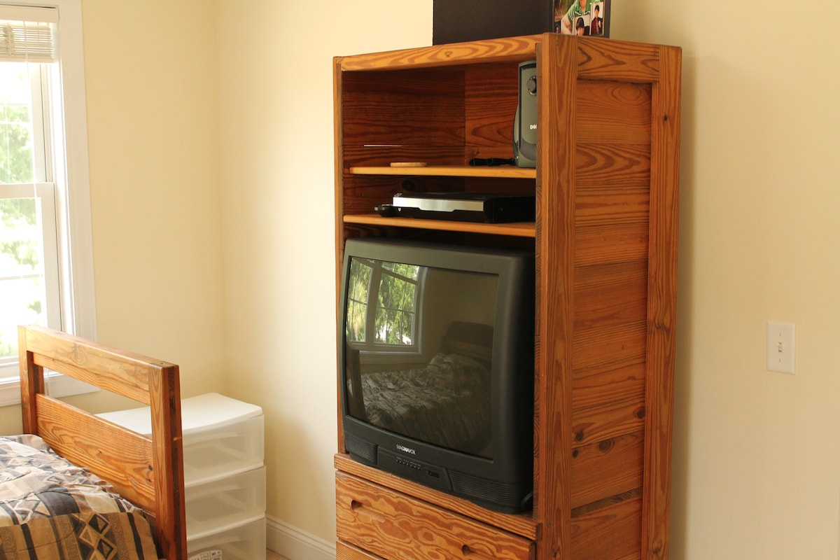 Dresser drawers with TV connected to Time Warner Cable.