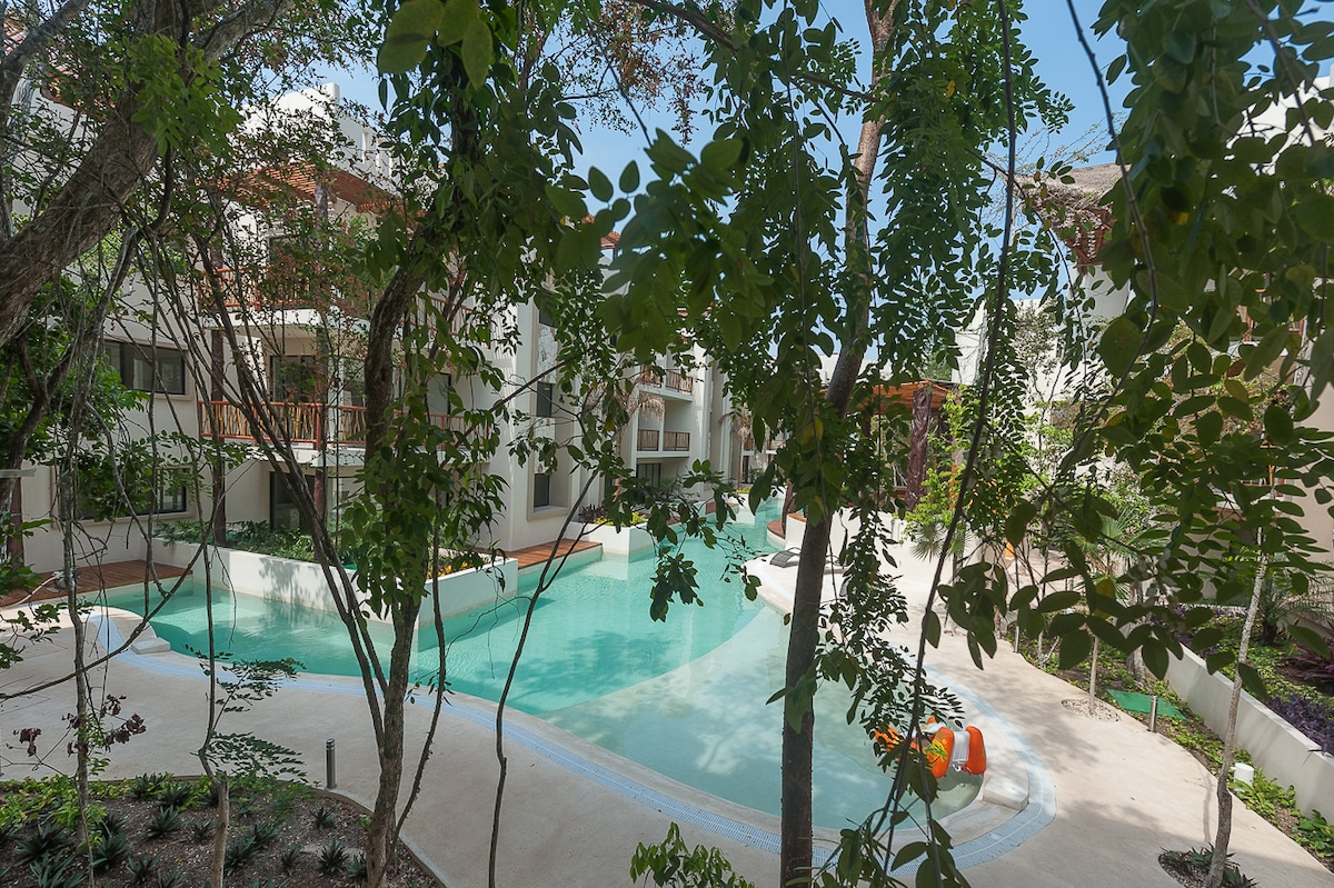 The view form the balcony, lots of trees to give you privacy but still can see the view of pool